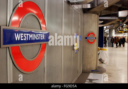 Passengers walk along a platform in Westminster tube station in London February 18, 2016. Copyright photograph  - Stock Photo
