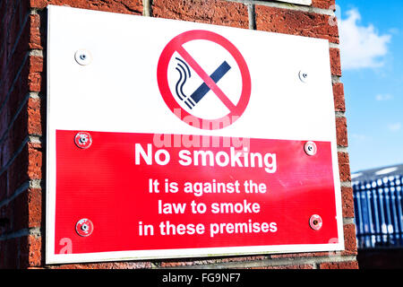 No Smoking sign UK law England GB against the law to smoke in these premises - Stock Photo