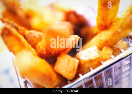 Close-Up Of French Fries In Container - Stock Photo
