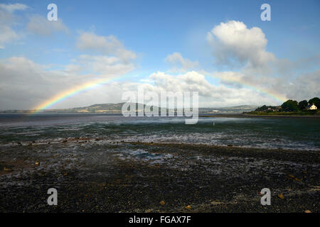 Rainbow over Strangford Lough sea loch inlet county Down shower showery weather RM Ireland - Stock Photo