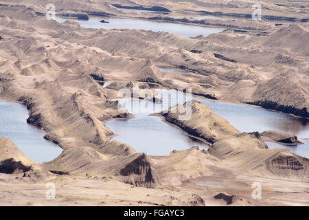 Former brown coal (lignite) open pit mine during renaturation, the future Zwenkauer See, south of Leipzig, Saxony, - Stock Photo