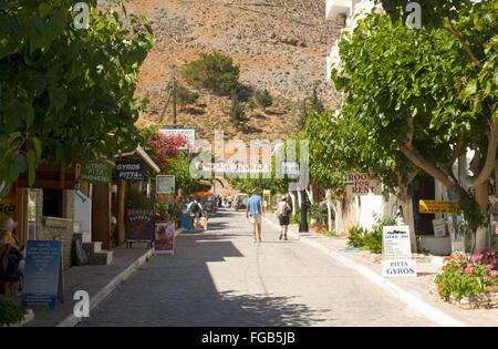 Griechenland, Kreta, Agios Rumeli, viele Imbissbuden und Fast Food Restaurants in der Hauptstrasse - Stock Photo
