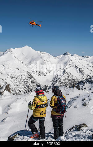 Skiers waiting for helicopter - Stock Photo
