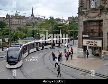 31st May 2014, A westbound tram turns into Princes street, Edinburgh on the first official day of service, Edinburgh, - Stock Photo