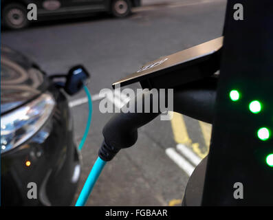 Plug in car charging point for an electric powered Renault ZOE car Covent Garden London UK - Stock Photo