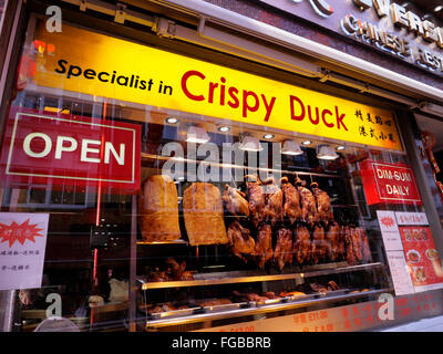 CRISPY PEKING DUCK SOHO Window display of Peking crispy duck hanging air drying in Dim Sum Chinese restaurant Gerrard - Stock Photo