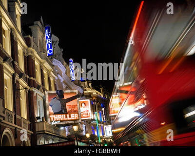 Theatreland busy with red buses in Shaftesbury Avenue West End London UK - Stock Photo