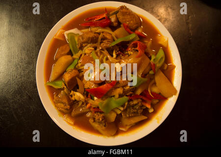 Uyghur cuisine: handmade noodles fried with chicken and vegetables - Stock Photo
