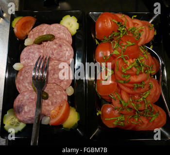 High Angle View Of Salad With Salami And Tomato On Tray - Stock Photo