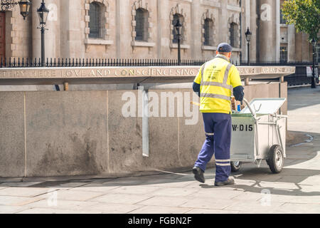 Street cleaner working in London city - Stock Photo