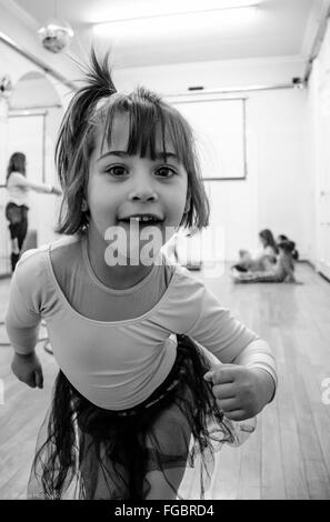 Portrait Of Cute Girl Making Face At Studio - Stock Photo