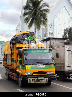 Garbage trucks on the way to the dump site Quezon City Integrated Waste Disposal Facility at Barangay (village) - Stock Photo