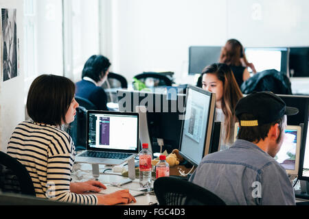 People Working On Computers At Office - Stock Photo