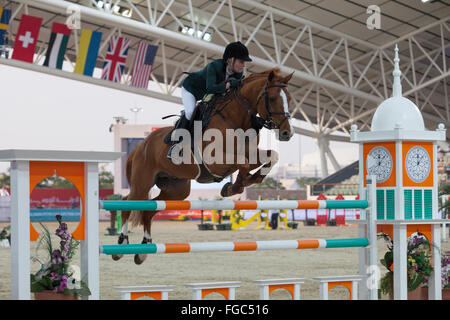 Rider competing in Show Jumping competition at CHI Al Shaqab 2014 - Stock Photo