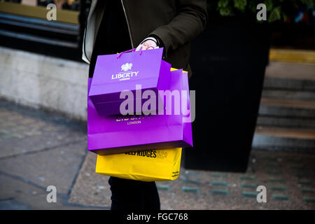 London, UK. 23rd December 2015 - Christmas shopper with shopping bags in Regent Street in London's West End. - Stock Photo