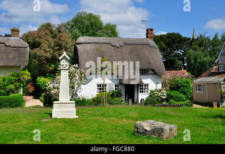 Cross on Martin village green in Hampshire, UK - Stock Photo
