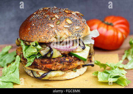 Veggie burger with onion, courgette, aubergine - Stock Photo