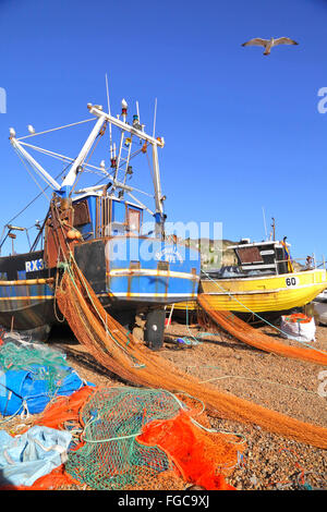 Hastings UK. Colourful nets and fishing boats on the Hastings Stade fishermen's beach, Hastings, East Sussex, England, - Stock Photo