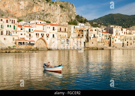 Fishermen in the old port in front of the historic centre, Cefalù, Province of Palermo, Sicily, Italy - Stock Photo
