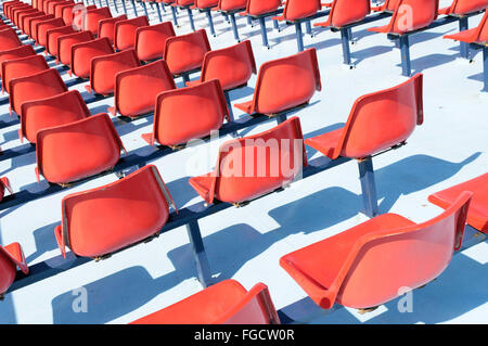 Rows of empty red seats on the upper deck of a passenger ferry - Stock Photo