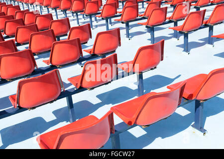 Red seats on the upper deck of a passenger ferry - Stock Photo