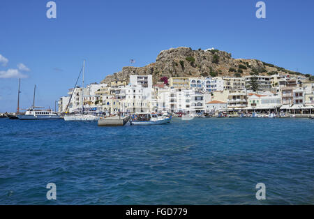View of coastal town with boats in harbour, Pigadia, Karpathos, Dodecanese Islands, Aegean Sea, Greece, June - Stock Photo