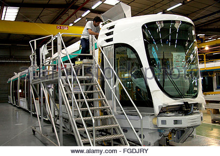 An electrician works on the electric board of a tram, Alstom factory, La Rochelle, Charente Maritime, France - Stock Photo
