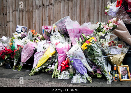 Flowers were laid behind Wood Green Crown Court in North London on December 16, 2015 for police shooting victim - Stock Photo
