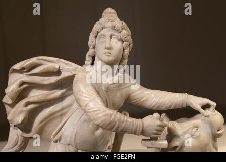 The Roman cult of Mithras. Tauroctony. Mithras killing the bull. Marble. Roman statue. Louvre Museum. Paris. France. - Stock Photo