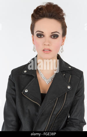 Young woman in leather outfit, Fashion - Stock Photo