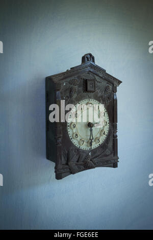 Antique cuckoo clock on wall - Stock Photo