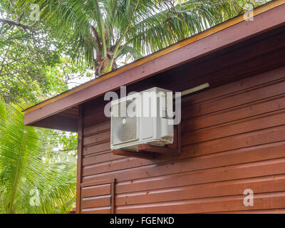 Air conditioning heat pump on vacation bungalow - Stock Photo