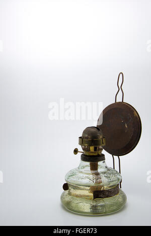 Old kerosene lamp isolated on white background - Stock Photo