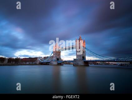 Sunset long exposure on Tower Bridge, London England UK - Stock Photo