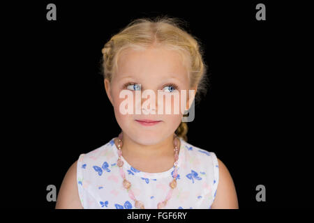 Portrait of a young girl with blonde hair, smiling - Stock Photo