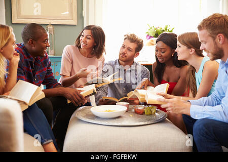 Group Of Friends Taking Part In Book Club At Home - Stock Photo