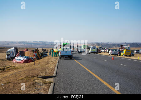 Accident scene along the highway involving many vehicles - Stock Photo
