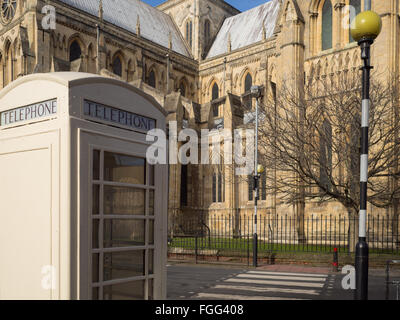 A Kingston Communication telephone box opposite Beverley Minster - Stock Photo