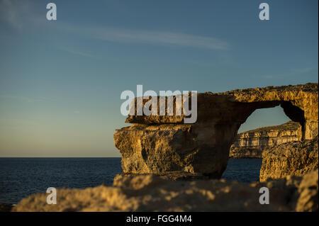 The Azure window on Gozo, Malta at sunset. - Stock Photo