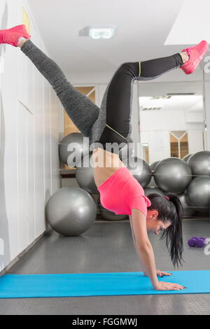 Attractive young women exercising in the gym - Stock Photo