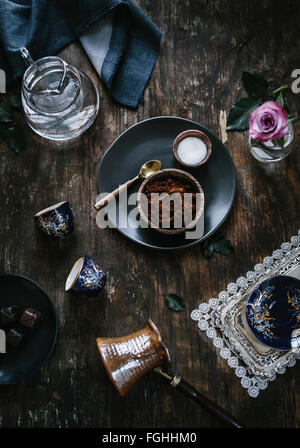 Ingredients (coffee sugar and water) for Turkish Coffee are photographed from the top. - Stock Photo