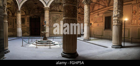 Interior garden view of historical Vecchio Palace with scluptures on columns, in Florence. - Stock Photo