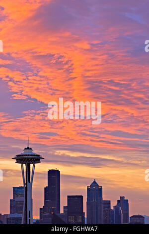 Colorful clouds during sunrise above the city of Seattle and the famous Space Needle landmark, Washington State, - Stock Photo