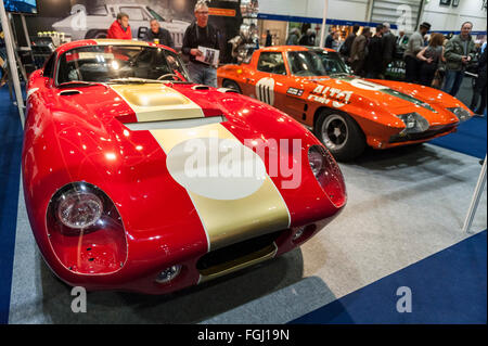 London, UK.  19 February 2016. (L to R) A Cobra Daytona Coupe and a Chevrolet Corvette Stingray on display as visitors - Stock Photo