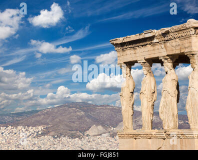 Athens - The statues of Erechtheion on Acropolis and the town in morning light. - Stock Photo