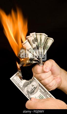 Money Being Burned - Stock Photo