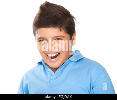 Portrait of cute happy teen boy laughing in the studio, showing white healthy teeth, dental care, cheerful kid isolated - Stock Photo