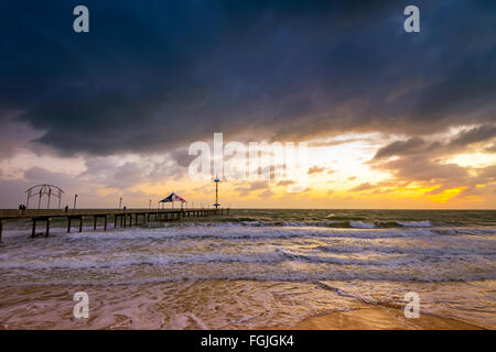 Dramatic sunset at Brighton Jetty and storm, South Australia - Stock Photo