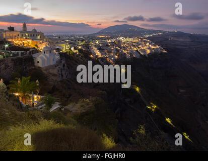 SANTORINI, GREECE - OCTOBER 5, 2015: The Fira at morning dusk from Firostefani - Stock Photo