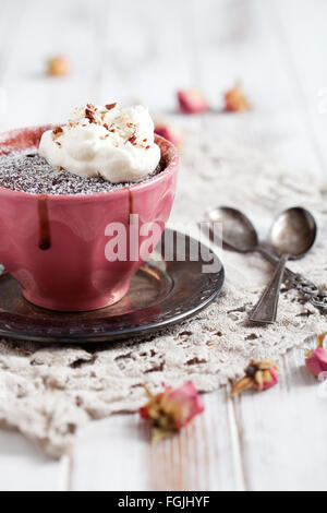 Homemade chocolate mug cake with icing sugar - Stock Photo